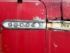 Badge on Rusty Dodge Truck