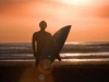 piha-sunset-surfer-flared